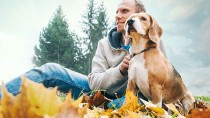 Man outside with dog